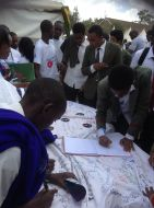 High school students signing as HeForShe Champions during Career Week at Graduation Square
